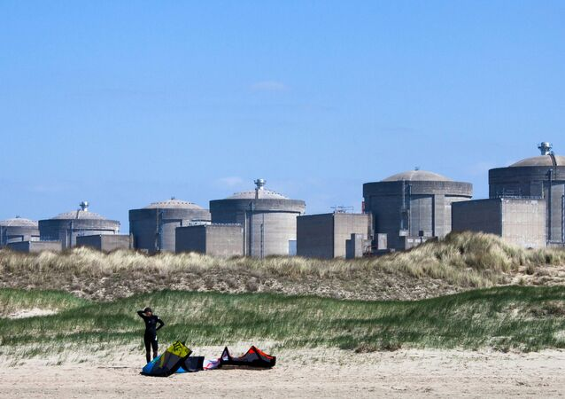 A kite surfer prepares in front of the Gravelines nuclear plant in Gravelines, near Dunkirk, northern France