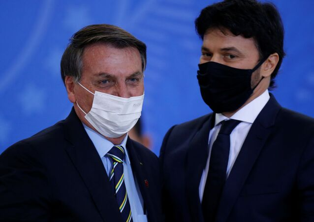 Brazil's President Jair Bolsonaro greets the new Communications Minister Fabio Faria during his inauguration ceremony at the Planalto Palace, in Brasilia, Brazil June 17, 2020