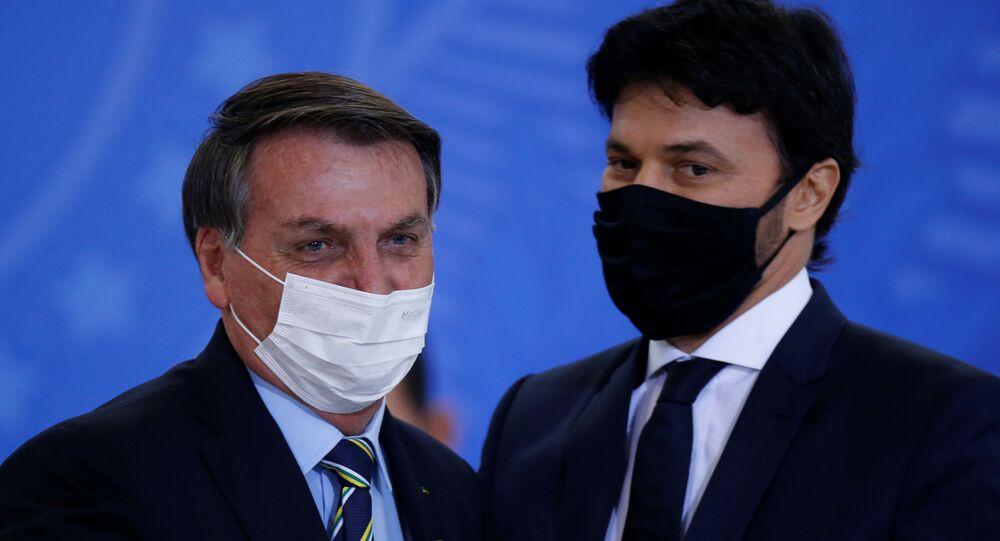 Brazil's President Jair Bolsonaro greets the new Communications Minister Fabio Faria during his inauguration ceremony at the Planalto Palace, in Brasilia, Brazil June 17, 2020
