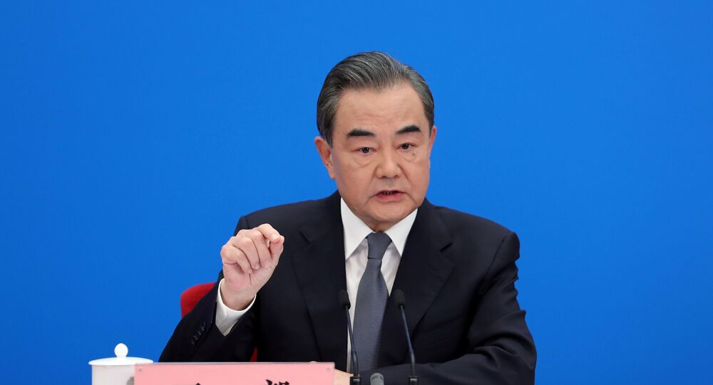 Chinese State Councillor and Foreign Minister Wang Yi speaks to reporters via video link at a news conference held on the sidelines of the National People's Congress (NPC), from the Great Hall of the People in Beijing, China May 24, 2020.
