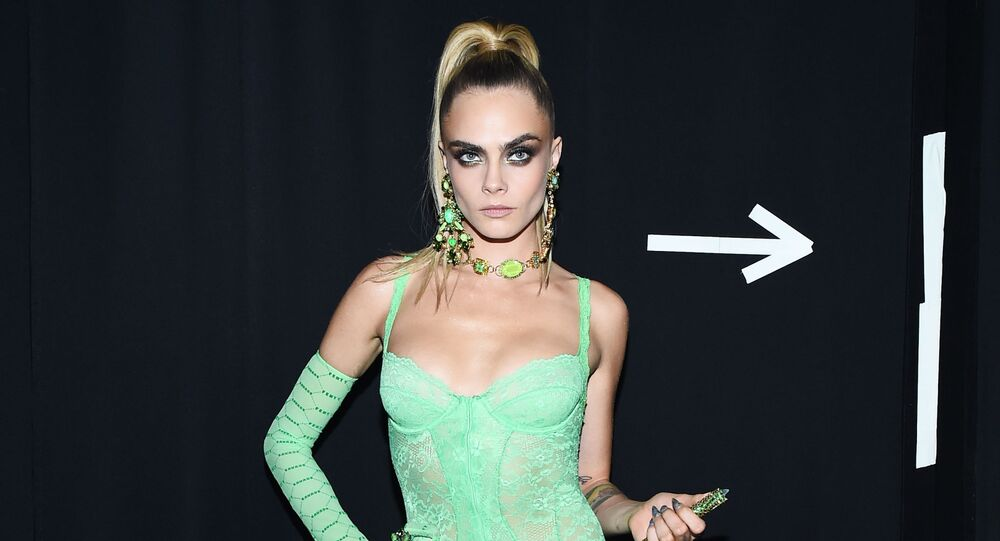 Cara Delevigne prepares backstage for Savage X Fenty Show Presented By Amazon Prime Video - Backstage at Barclays Center on September 10, 2019 in Brooklyn, New York