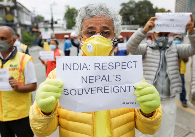 Activists affiliated with 'Human Rights and Peace Society Nepal' holding placards protest against the alleged encroachment of Nepal's border by India in the far west of Nepal, near the Indian Embassy in Kathmandu, Nepal May 12, 2020.
