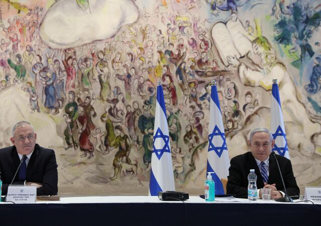 Israeli Prime Minister Benjamin Netanyahu and Defense Minister Benny Gantz attend a cabinet meeting of the new government at the Chagall Hall in the Knesset, the Israeli Parliament in Jerusalem May 24, 2020.