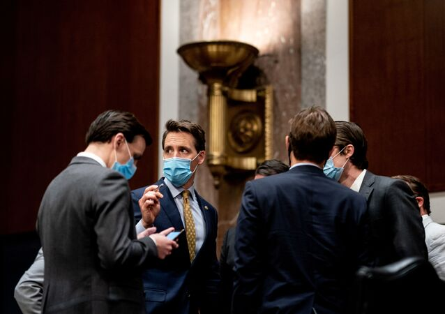 Senator Joshua Josh Hawley (R-MO) talks with a fellow Senator and aides during a Senate Judiciary Committee business meeting to consider authorization for subpoenas relating to the Crossfire Hurricane investigation and other matters on  Capitol Hill in Washington, U.S.,  June 11, 2020