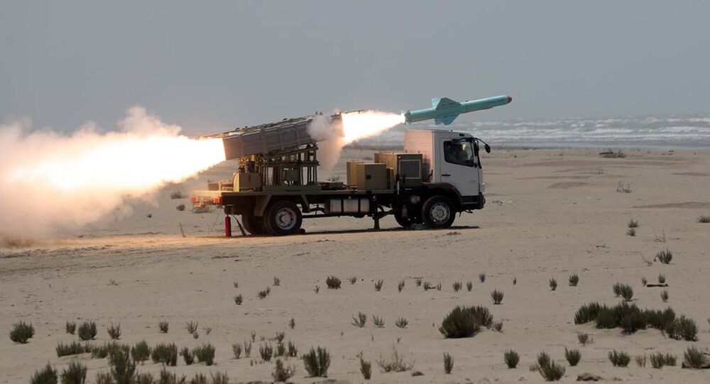 This picture made available by the Iranian armed forces office on June 18, 2020 shows a missile being fired out to sea from a mobile launch vehicle reportedly on the southern coast of Iran along the Gulf of Oman during a military exercise. - Iran test-fired a new generation of cruise missiles on June 18, the navy said