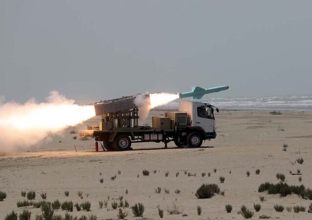 This picture made available by the Iranian armed forces office on 18 June 2020 shows a missile being fired out to sea from a mobile launch vehicle reportedly on the southern coast of Iran along the Gulf of Oman during a military exercise.