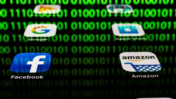 This illustration picture taken on April 20, 2018 in Paris shows apps for Google, Amazon, Facebook, Apple (GAFA) and the reflexion of a binary code displayed on a tablet screen - Sputnik International