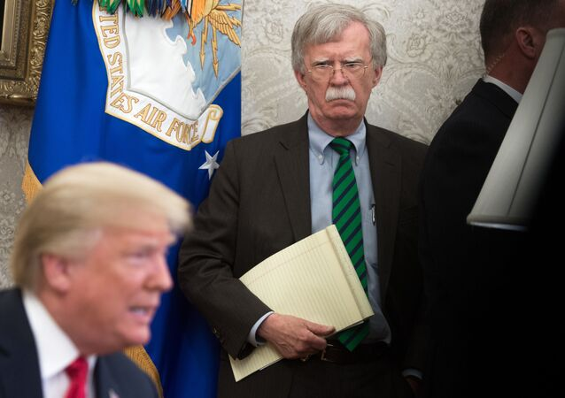 In this file photo National Security Adviser John Bolton stands alongside US President Donald Trump as he speaks during a meeting with NATO Secretary General Jens Stoltenberg in the Oval Office of the White House in Washington, DC, May 17, 2018. - The US Justice Department filed an emergency order Wednesday seeking to halt release of ex-national security advisor John Bolton's book, the second time in two days that President Donald Trump tried to block the tell-all memoir.