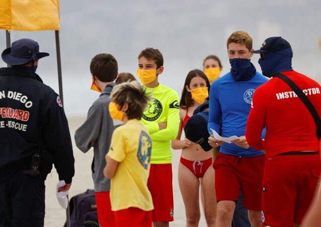 Instructors gather participants on the beach as San Diego's Junior Lifeguard Program officially reopens with new protocols in place to comply with county health guidelines for novel coronavirus safety during the outbreak of COVID-19 in San Diego, California, U.S., June 15, 2020