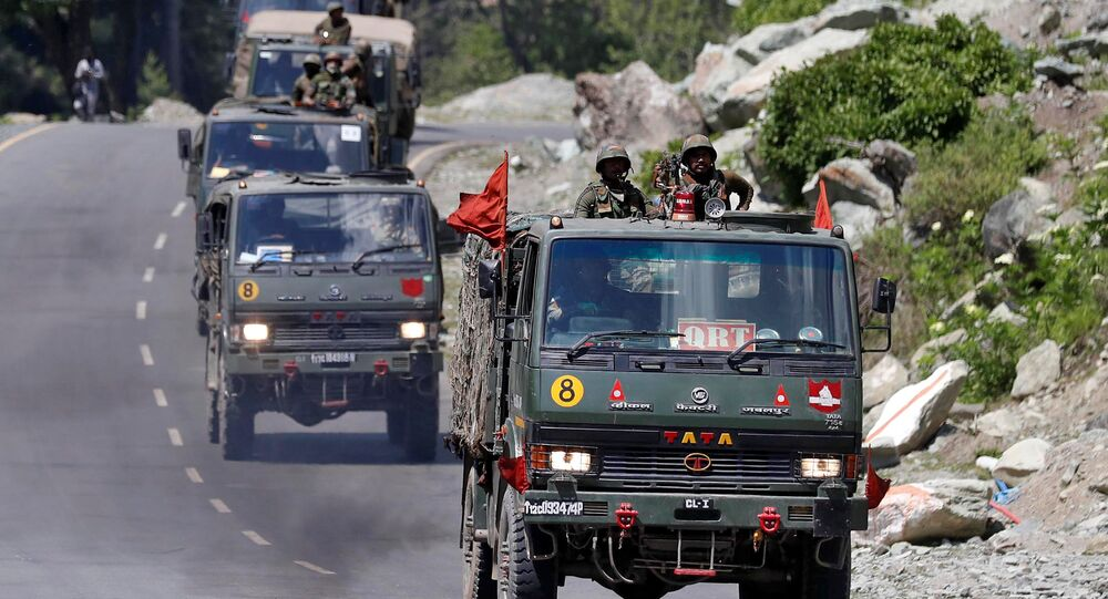 An Indian Army convoy moves along a highway leading to Ladakh, at Gagangeer in Kashmir's Ganderbal district June 18, 2020