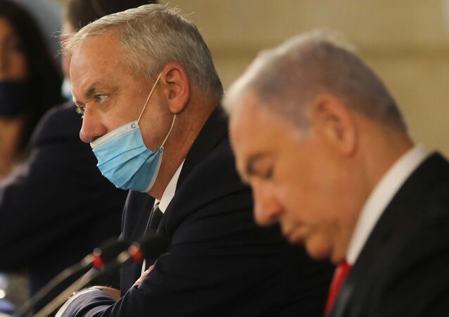 Israeli Prime Minister Benjamin Netanyahu and Alternate Prime Minister and Defence Minister Benny Gantz attend the weekly cabinet meeting in Jerusalem June 7, 2020.