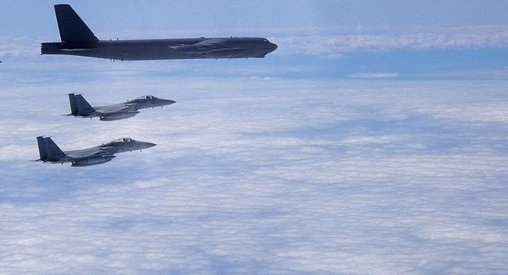 A B-52H Stratofortress deployed from Barksdale Air Force Base, La., flies alongside two Japan Air Self-Defense Force F-15s over the Sea of Japan while conducting a Bomber Task Force mission June 16, 2020. Bomber Task Force missions help maintain global stability and security while enabling units to become familiar with operations in different regions