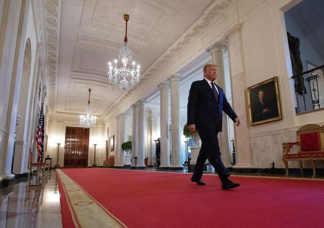 U.S. President Donald Trump walks down Cross Hall ahead of an event held to discuss an administration plan aimed at helping to prevent suicides by U.S. veterans and other Americans, at the White House in Washington, U.S., June 17, 2020.