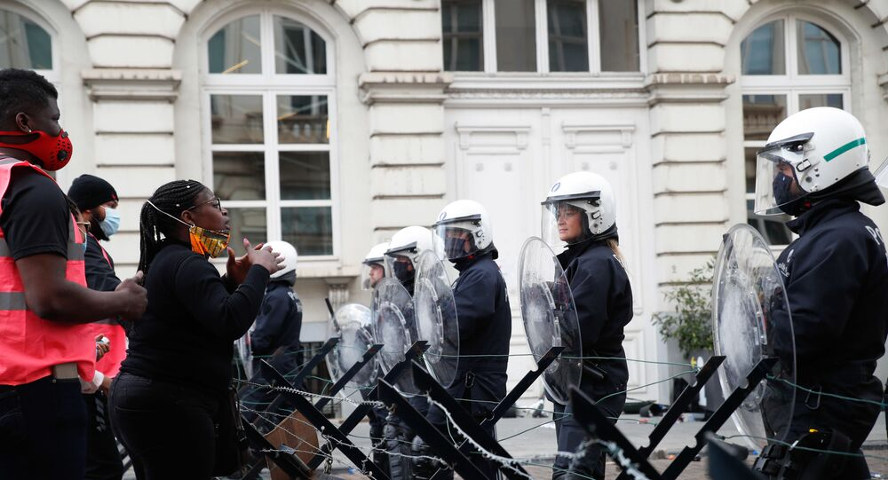 Demonstrators argue with riot police during an anti-racism protest, in Brussels, on June 7, 2020, as part of a weekend of 'Black Lives Matter' worldwide protests against racism and police brutality in the wake of the death of George Floyd, an unarmed black man killed while apprehended by police in Minneapolis, US.