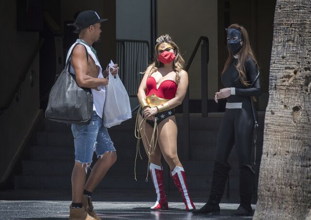 Street performers dressed as movie characters wait for customers to take photos, on Hollywood Blvd, Hollywood, California on 12 June 2020.