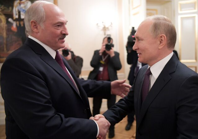 Russian President Vladimir Putin shakes hands with Belarusian President Alexander Lukashenko during a meeting in St. Petersburg, Russia.