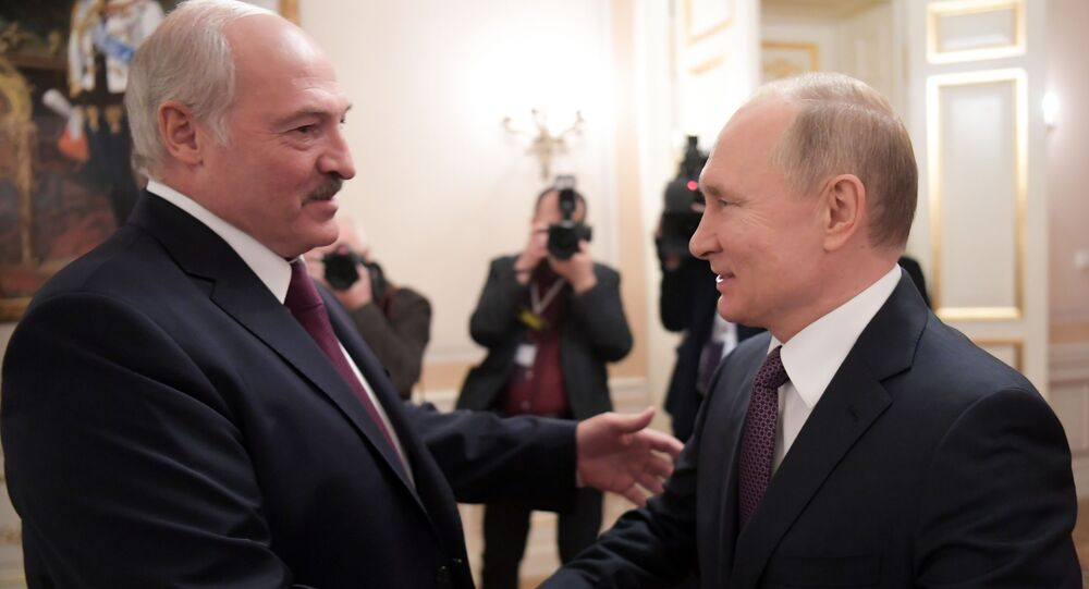Russian President Vladimir Putin shakes hands with Belarusian President Alexander Lukashenko during a meeting, in St. Petersburg, Russia