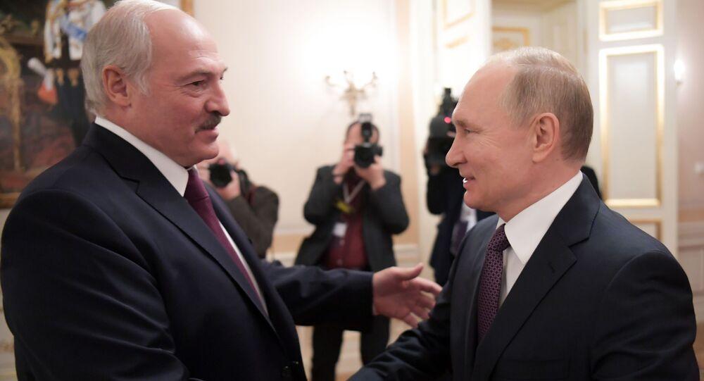Russian President Vladimir Putin shakes hands with Belarusian President Alexander Lukashenko during a meeting in St. Petersburg, Russia.