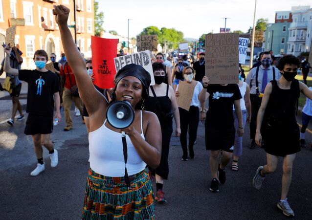 Shannon Greaves helps lead a Juneteenth Awareness Walk to demonstrate against racial inequality in the aftermath of the death in Minneapolis police custody of George Floyd, in Boston, Massachusetts, U.S., June 18, 2020