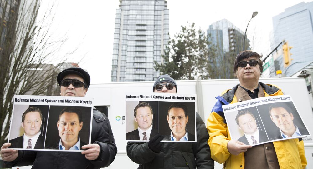 Protesters hold photos of Canadians Michael Spavor and Michael Kovrig, who are being detained by China, outside British Columbia Supreme Court, in Vancouver, on March 6, 2019, as Huawei Chief Financial Officer Meng Wanzhou appears in court. - Meng Wanzhou, the Chinese telecom executive at the center of an escalating row between Ottawa and Beijing, was due in court in Canada to get a date for a hearing into a US extradition request. Meng's arrest in Vancouver in December on a US warrant infuriated China, which arrested several Canadians days later in what was widely seen as retaliation. A Canadian judge on Wednesday who set May 8 for the start of a hearing into a US extradition request.