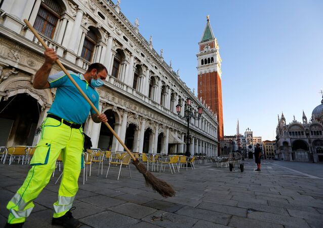 A city worker cleans the Piazzetta next to St. Mark's Square, amid the coronavirus disease (COVID-19) outbreak, in Venice, Italy June 19, 2020