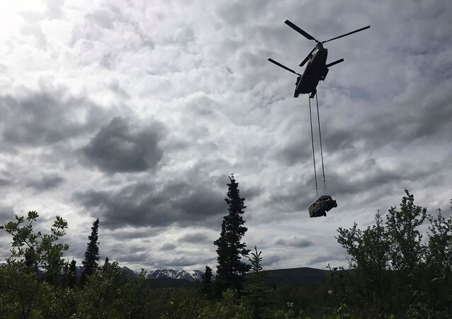 An Alaska Army National Guard CH-47 Chinook helicopter carries the bus made famous by the Into the Wild book and movie during its relocation near Stampede Trail west of Healy, Alaska, U.S. June 18, 2020. Alaska Department of Natural Resources/Handout via REUTERS.  THIS IMAGE HAS BEEN SUPPLIED BY A THIRD PARTY.