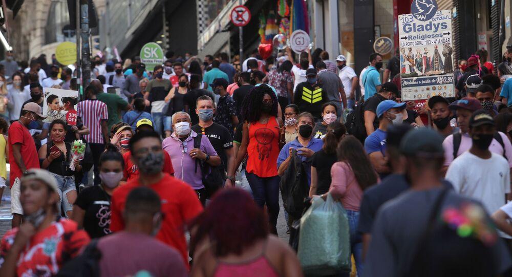 People walk at a popular shopping street amid the coronavirus disease (COVID-19) outbreak, in Sao Paulo, Brazil, June 19, 2020.
