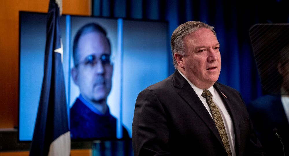 An image of Paul Whelan, a former U.S. marine who was arrested for alleged spying in Moscow, is displayed behind Secretary of State Mike Pompeo, as he speaks during  a news conference at the State Department in Washington, DC, U.S., June 10, 2020