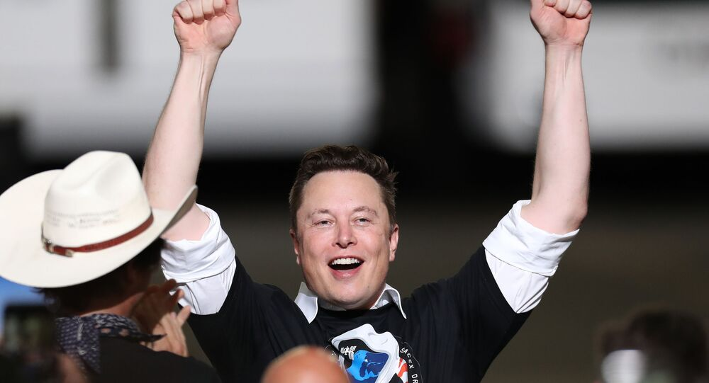 Spacex founder Elon Musk celebrates after the successful launch of the SpaceX Falcon 9 rocket with the manned Crew Dragon spacecraft at the Kennedy Space Center on May 30, 2020 in Cape Canaveral, Florida.