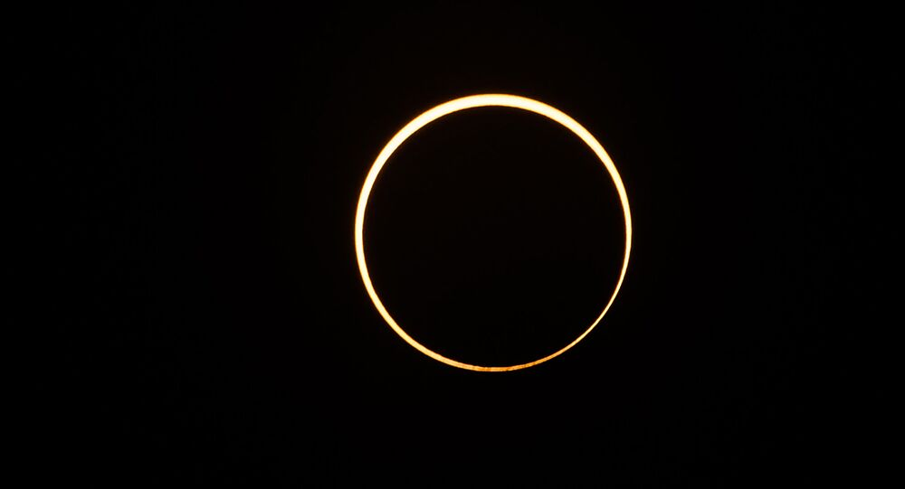 The moon moves in front of the sun in a rare ring of fire solar eclipse as seen from Singapore on December 26, 2019.