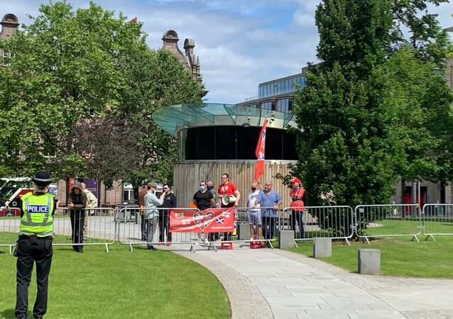 A Force For Good counter-protestors gather at the Melville Monument in St Andrew's Square
