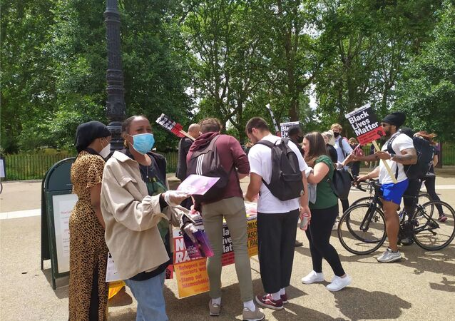 Members of the Socialist Worker handing out leaflets as part of the protest organised by groups operating under the BLM theme