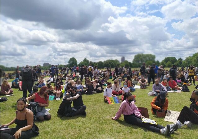 Groups of people, thus far in the hundreds, are slowly gathering in Hyde Park waiting for more people  to arrive.