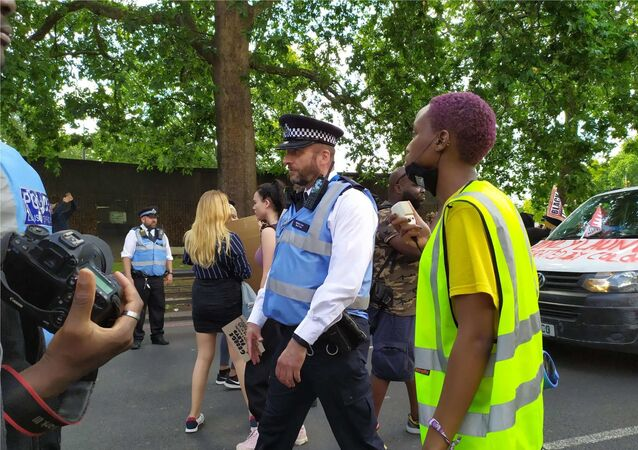 Police have stopped the march at its outset as it appears organisers were negotiating with them