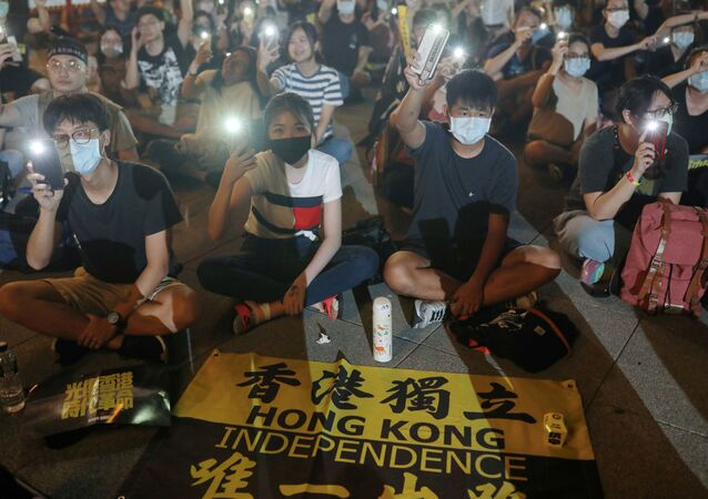 Supporters of Hong Kong anti-government movement gather at Liberty Square, to mark the one-year anniversary of the start of the protests in Hong Kong, in Taipei, Taiwan, June 13, 2020.