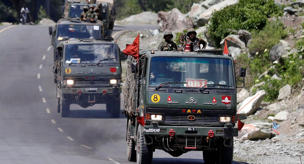 An Indian Army convoy moves along a highway leading to Ladakh, at Gagangeer in Kashmir's Ganderbal district June 18, 2020.