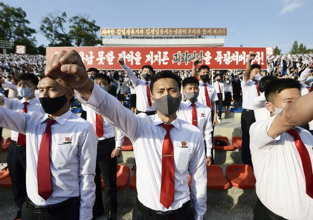 North Korea's youth and students wearing protective face masks hold an outdoor rally in protest of the leaflets launched by defectors in South Korea that condemned the Kim Jong Un's regime in Pyongyang, North Korea, in this photo taken June 6, 2020 and released by Kyodo on June 7, 2020.