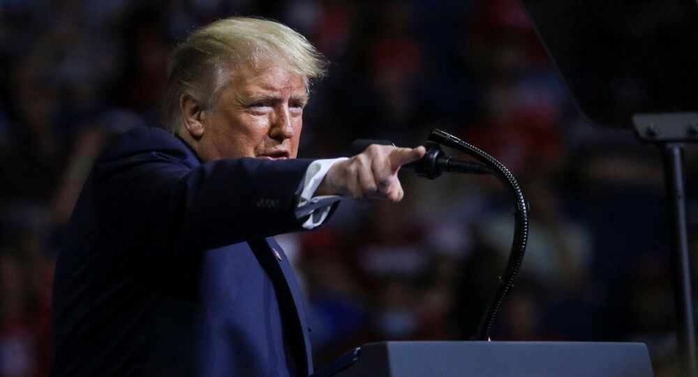 U.S. President Donald Trump points into the crowd as he speaks during his first re-election campaign rally in several months in the midst of the coronavirus disease (COVID-19) outbreak, at the BOK Center in Tulsa, Oklahoma, U.S., June 20, 2020.