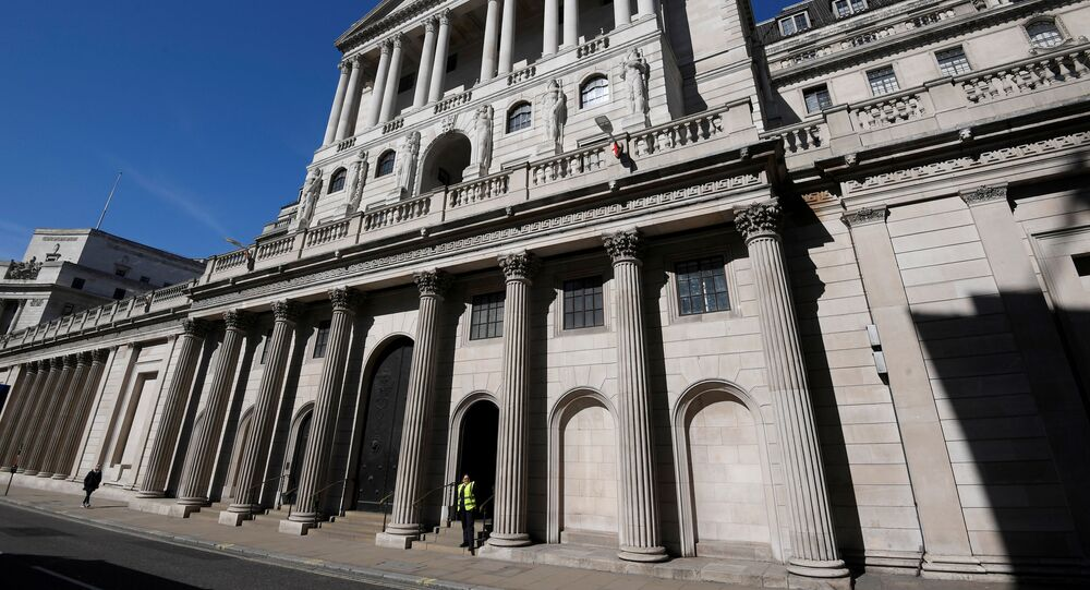 A security officer stands outside the Bank of England in London, Britain, March 23, 2020.