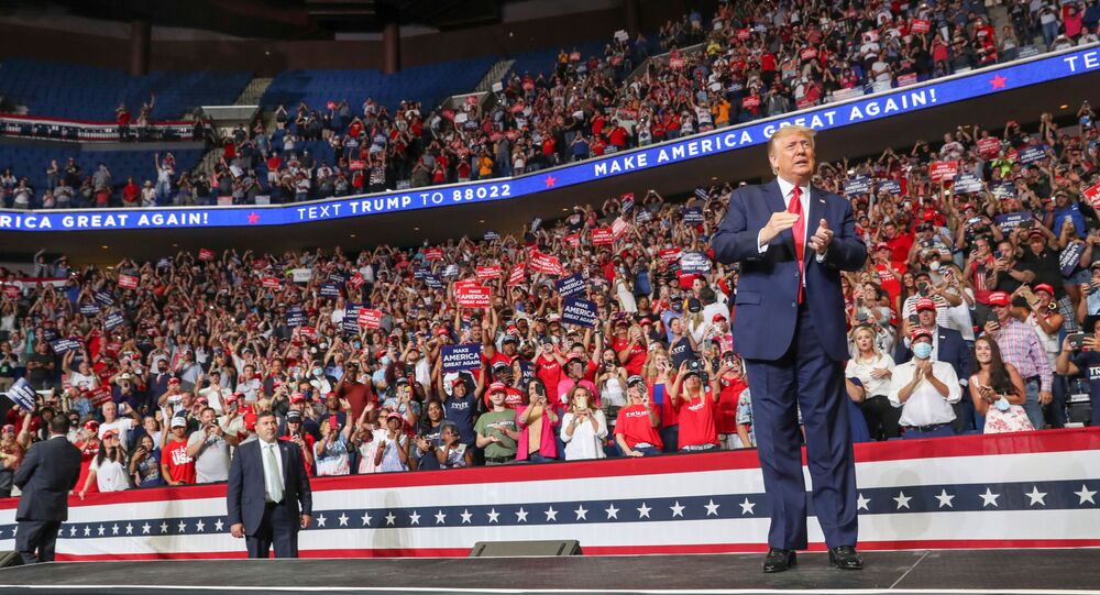 U.S. President Donald Trump reacts to the crowd as he arrives onstage at his first re-election campaign rally in several months in the midst of the coronavirus disease (COVID-19) outbreak, at the BOK Center in Tulsa, Oklahoma, U.S., June 20, 2020.