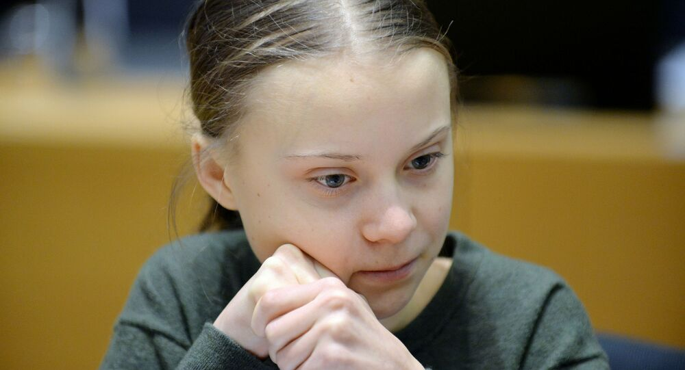 Swedish climate activist Greta Thunberg looks on before the meeting with EU environment ministers in Brussels, Belgium, March 5, 2020