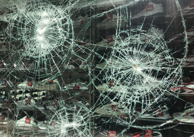 A smashed window is seen in Stuttgart's main shopping street after a group of looters smashed several windows in Stuttgart, Germany, 21 June 2020.