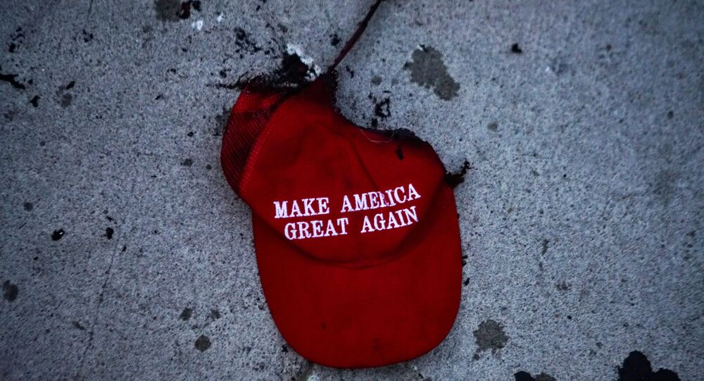 A burnt Make America Great Again (MAGA) hat lies on the ground during a protest against racial injustice near the site of a rally by U.S. President Donald Trump in Tulsa, Oklahoma, U.S., June 20, 2020.