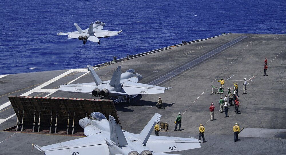 """An E/A-18G Growler, assigned to the """"Gray Wolves"""" of Electronic Attack Squadron (VAQ) 142, launches from the flight deck of the aircraft carrier USS Theodore Roosevelt (CVN 71) June 17, 2020. The Theodore Roosevelt Carrier Strike Group is on a scheduled deployment to the Indo-Pacific."""