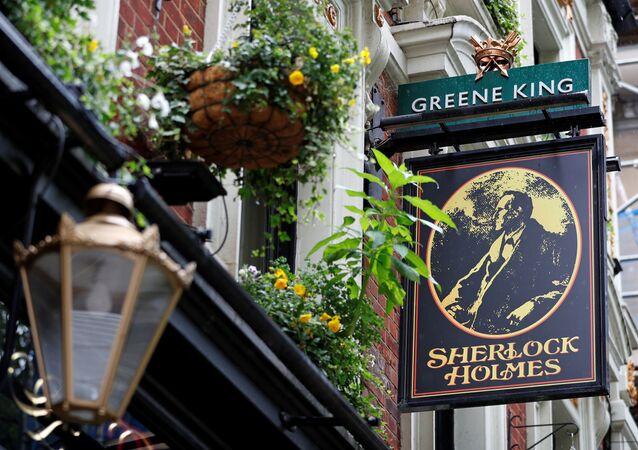 The Greene King logo is seen outside the Sherlock Holmes Pub, in London, Britain, June 18, 2020. REUTERS/Peter Nicholls