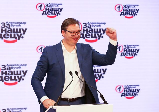 Serbian President Aleksandar Vucic gestures at Serbian Progressive Party (SNS) headquarters during a national election, the first in Europe since lockdown due to the coronavirus disease (COVID-19) outbreak, in Belgrade, Serbia, June 21, 2020.