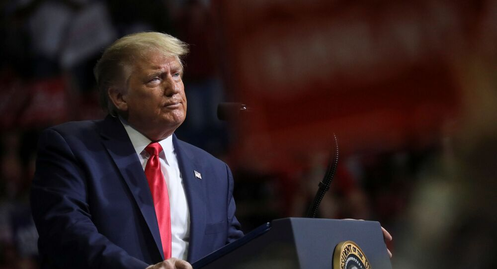 US President Donald Trump stands at the podium listening to his supporters cheer as he addresses his first re-election campaign rally in several months in the midst of the coronavirus disease (COVID-19) outbreak, at the BOK Center in Tulsa, Oklahoma, U.S., 20 June 2020.