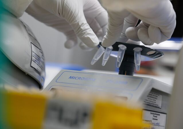 A scientist conducts sample​ sedimentation during the research and development of a vaccine against the coronavirus disease (COVID-19) at a laboratory of BIOCAD biotechnology company in Saint Petersburg, Russia June 11, 2020.