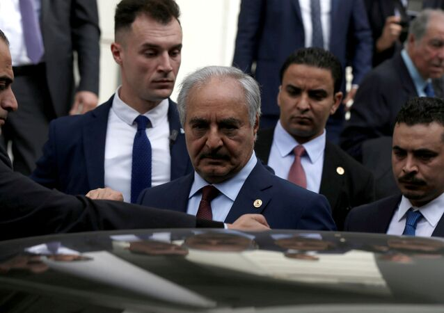 Libyan commander Khalifa Haftar gets into a car after a meeting with Greek Foreign Minister Nikos Dendias at the Foreign Ministry in Athens, Greece, January 17, 2020