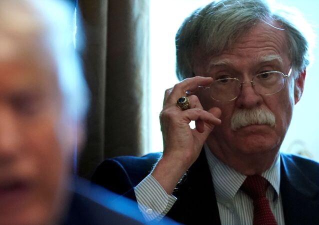 FILE PHOTO: National Security Adviser John Bolton listens as U.S. President Donald Trump holds a Cabinet meeting at the White House in Washington, U.S., April 9, 2018